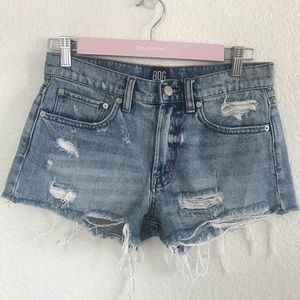 UO BDG Mid Rise Frayed Cheeky Shorts